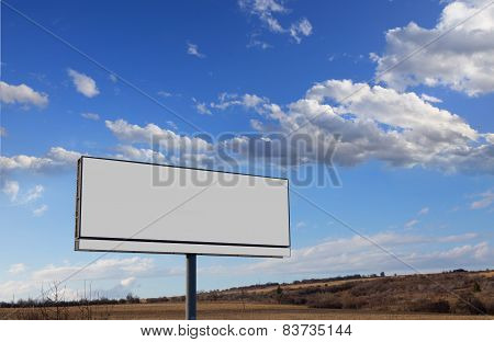 Vacant Billboard And Clouds In Sky