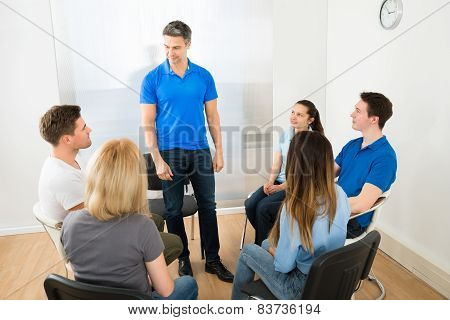 Man Explaining To His Friends