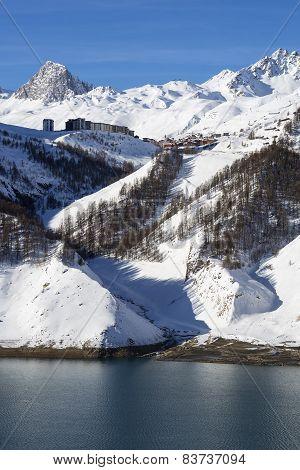 Tignes Village In Winter With Lake
