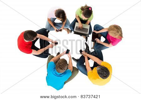 Group Of Friends Using Electronic Devices