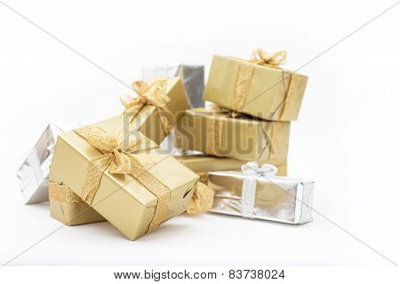 Beautiful Gifts In Gold And Silver Packaging For Christmas, Holidays, Isolated On White Background.