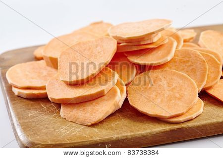 Chopped Sweet Potatoes On Wooden Board