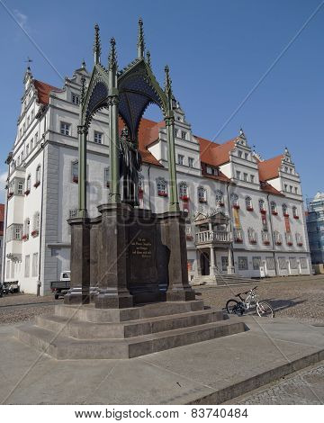 Luther statue and the town hall of Wittenberg Germany