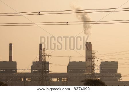 Industrial power plant with smokestack, the power plant production on hot condition in the mountain