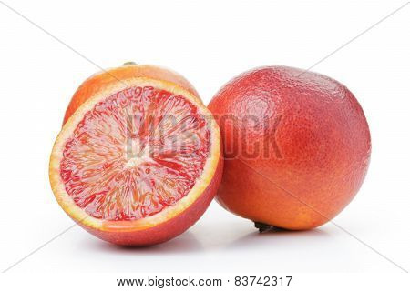 ripe blood red oranges with half isolated on white