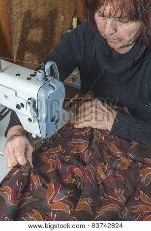 Woman And Sewing Machine