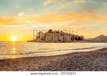 Sveti Stefan Island In Budva, Montenegro With A Beautiful Sunset In Hdr