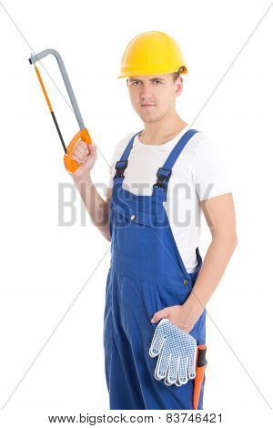 Handsome Man In Builder Uniform And Helmet With Manual Saw Isolated On White
