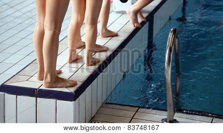 Legs Of Children During The Course Of Swimming Pool