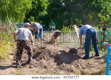 Gravediggers Digging The Grave In Bestuzhevo Village