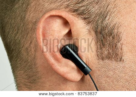 Ear With Earphone Closeup