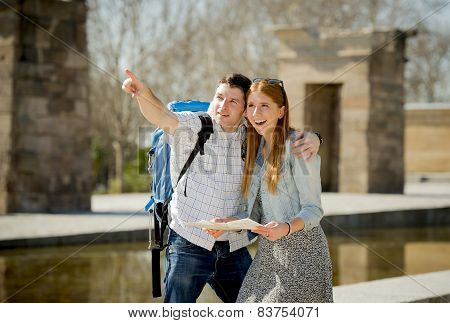 American Student And Tourist Couple Reading City Map In Tourism Concept