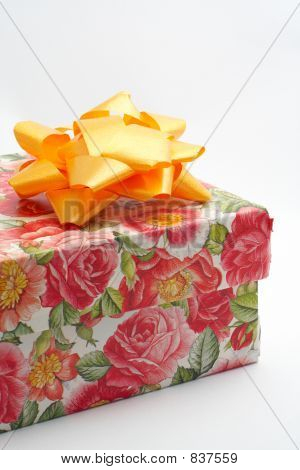Gift Box With Yellow Ribbon, Detail On White Background