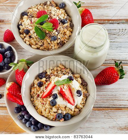 Healthy Breakfast With Ripe  Berries, Yogurt  And  Muesli.