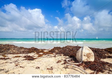 Old White Buoy Of Fishing Net Lays On The Beach