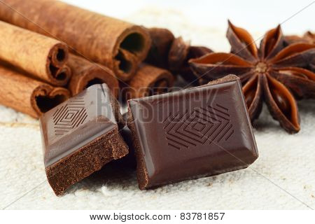 Closeup Set Of Chocolate,anise And Cinnamon On White Flax