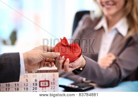 Happy woman hold Love symbol red heart. In office.