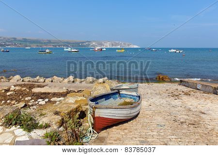 Swanage bay and coast with rowing boat Dorset England UK on a beautiful summer day