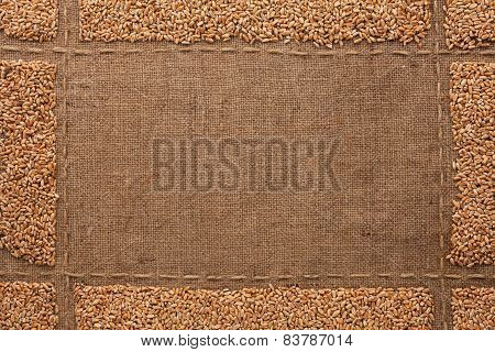 Beautiful Frame With Wheat Grains On Sackcloth