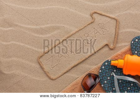 Zanzibar  Pointer And Beach Accessories Lying On The Sand