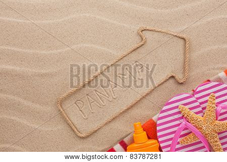 Panama Pointer And Beach Accessories Lying On The Sand