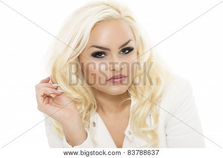 Pretty Young Female Touching Her Wavy Blond Hair