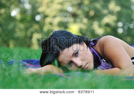 Very Sad - Young Woman In Grass