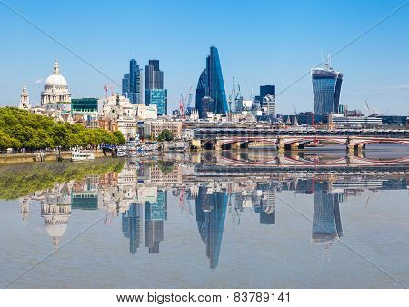 City of London view with reflection in Thames river