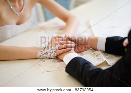 Bride and groom's hands at wedding ceremony