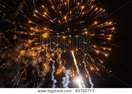 Cluster of colourful fireworks against dark sky