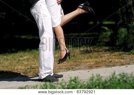 Young couple kissing in summer sun light
