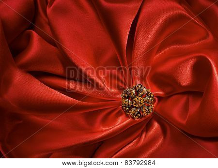 Jewelry Shape Over Red Silk Cloth Background, Fabric Abstract Folds