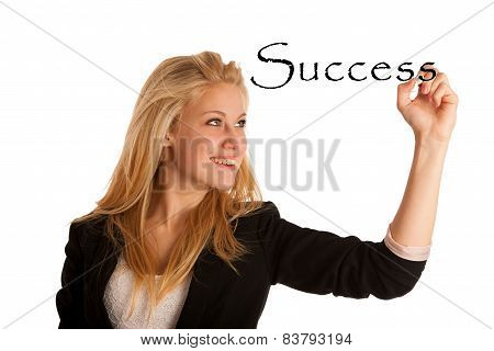 Young blond caucasian business woman writes success word on glass board