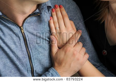 just engaged couple holding hands at restaurant