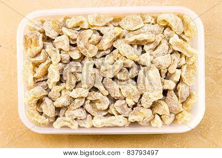 Close-up macro view of Sugar coated dried Indian Gooseberry kept in a box