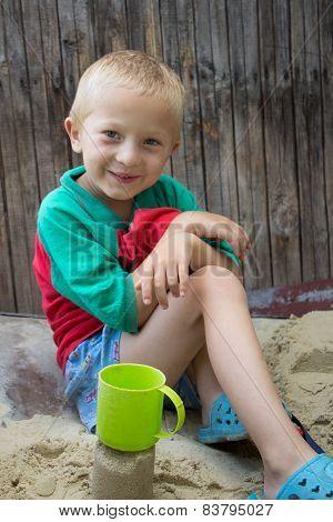 Happy Boy In Sand