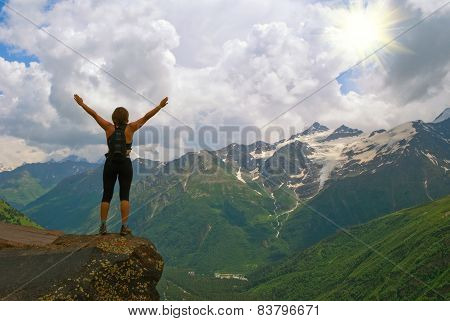 Young, beautiful girl in mountains