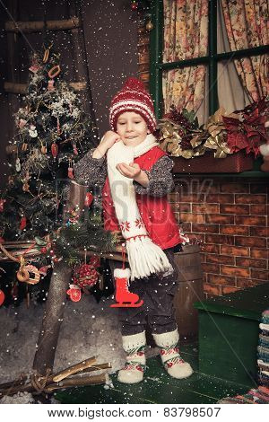 Young boy playing in a Christmas garden
