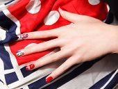 stock photo of gels  - Closeup of cool gel polished nails with england symbols - JPG