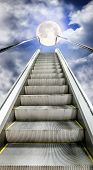 pic of escalator  - The escalator is moving up to the starry sky with a full moon - JPG