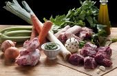 pic of veal meat  - ingredients for the preparation of meat broth with veal and different vegetables - JPG