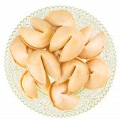 pic of scallops  - Close up of fortune cookies on a green scalloped glass plate isolated on white - JPG