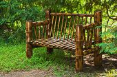 stock photo of bamboo forest  - Bamboo bench in a green summer forest - JPG