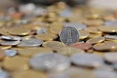 picture of coins  - One new Israeli shekel coin with other coins from other currencies and countries - JPG