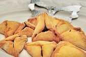 stock photo of purim  - A hamantash is a pastry in Ashkenazi Jewish cuisine traditionally eaten during the Jewish holiday of Purim - JPG