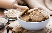 stock photo of oats  - Some Oat Cookies on rustic wooden background  - JPG