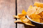 stock photo of nachos  - Heap of Nachos on rustic wooden background  - JPG