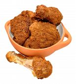 picture of southern fried chicken  - Cooked southern fried chicken portions in a bowl isolated on a white background  - JPG
