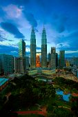 stock photo of klcc  - View of Kuala Lumpur skyline at sunset - JPG