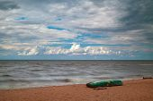 pic of stagnation  - Fishermen boat on the seaside windy summer - JPG